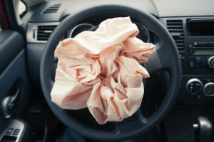 airbag in the midst of crash