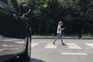 boy-crossing-with-cellphone