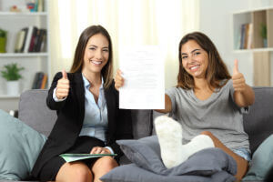 girl-with-broken-leg-on-couch-female-lawyer-thumbs-up
