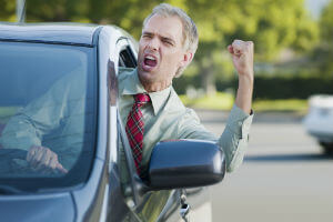 angry motorist shaking his fist